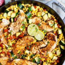 spicy chicken with corn and zucchini in pan