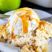 apple crisp on plate with ice cream and caramel