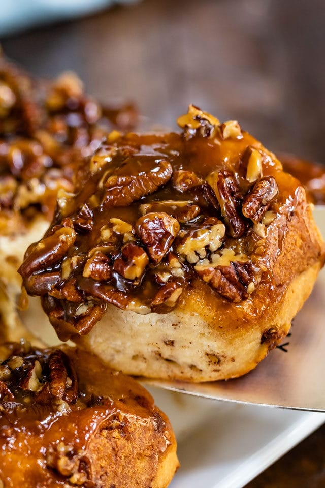 caramel pecan roll on spatula