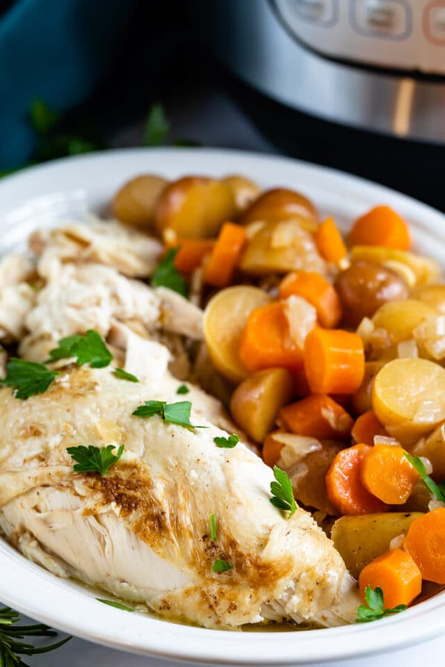 chicken pot roast and vegetables on plate with instant pot