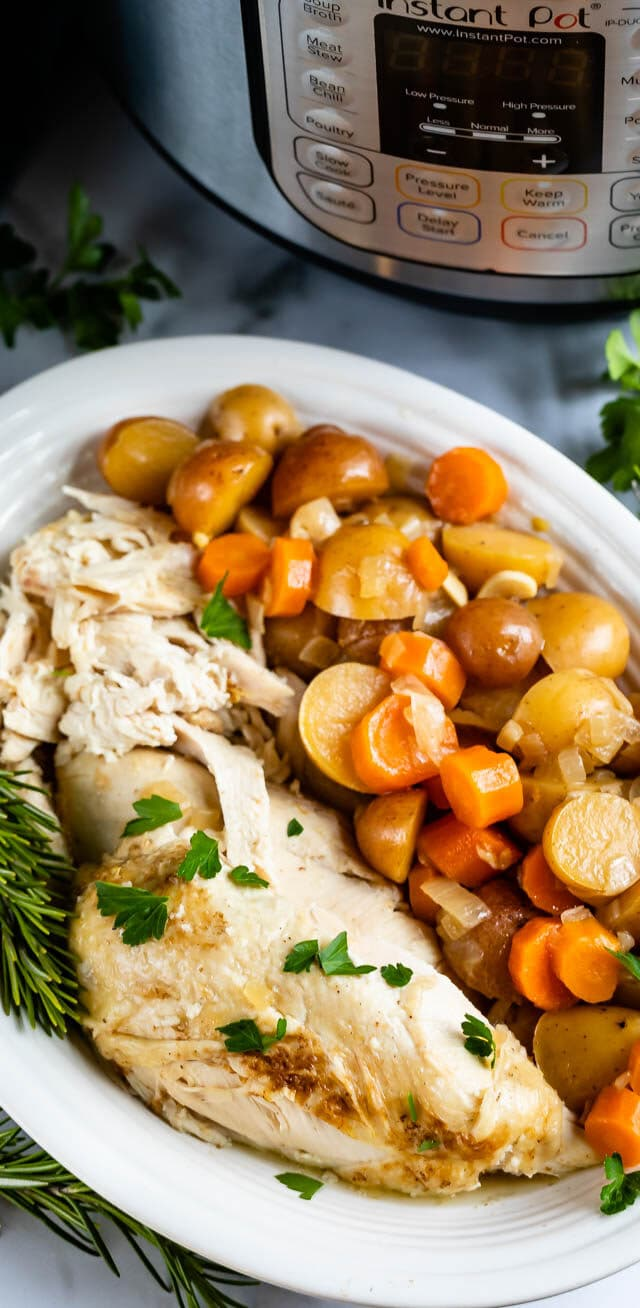 chicken and vegetables on white platter