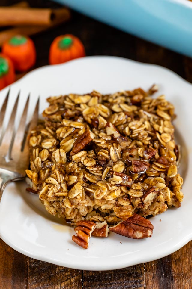 slice of pumpkin spice baked oatmeal on white plate