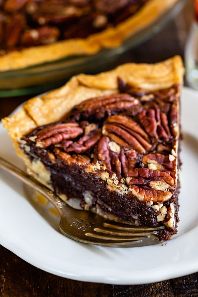 slicer of pecan pie on white plate