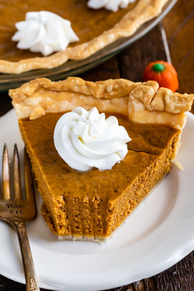slice of pumpkin pie with bite missing