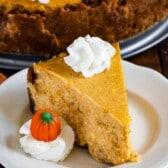 slice of pumpkin cheesecake on white plate