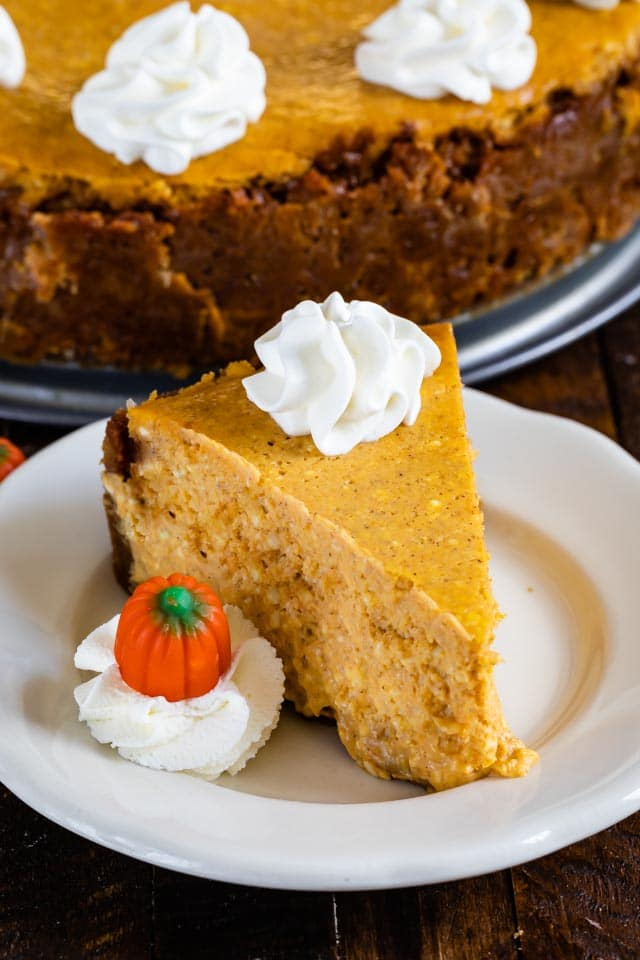 slice of pumpkin cheesecake on white plate