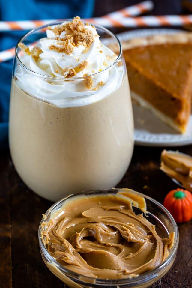 peanut butter smoothie in glass with whipped cream