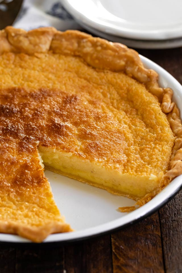 buttermilk pie in pie plate with slice missing