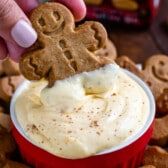 eggnog pudding dip with hand dipping gingerbread man