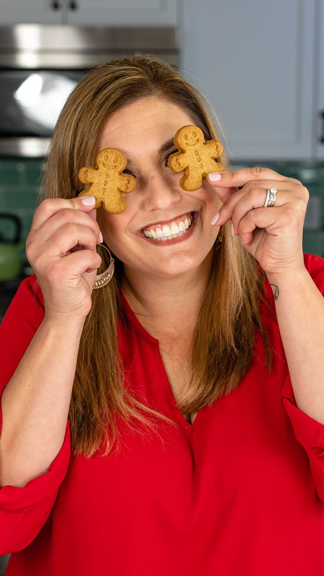 woman holding gingerbread cookies