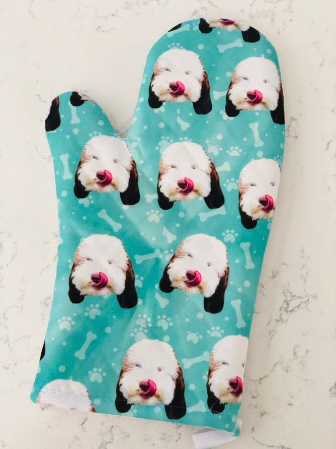 Oven mitt with dog faces all over it