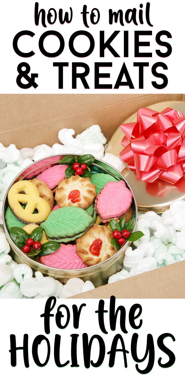 Tin full of holiday cookies and writing