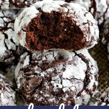 plate of chocolate crinkles one with bite missing