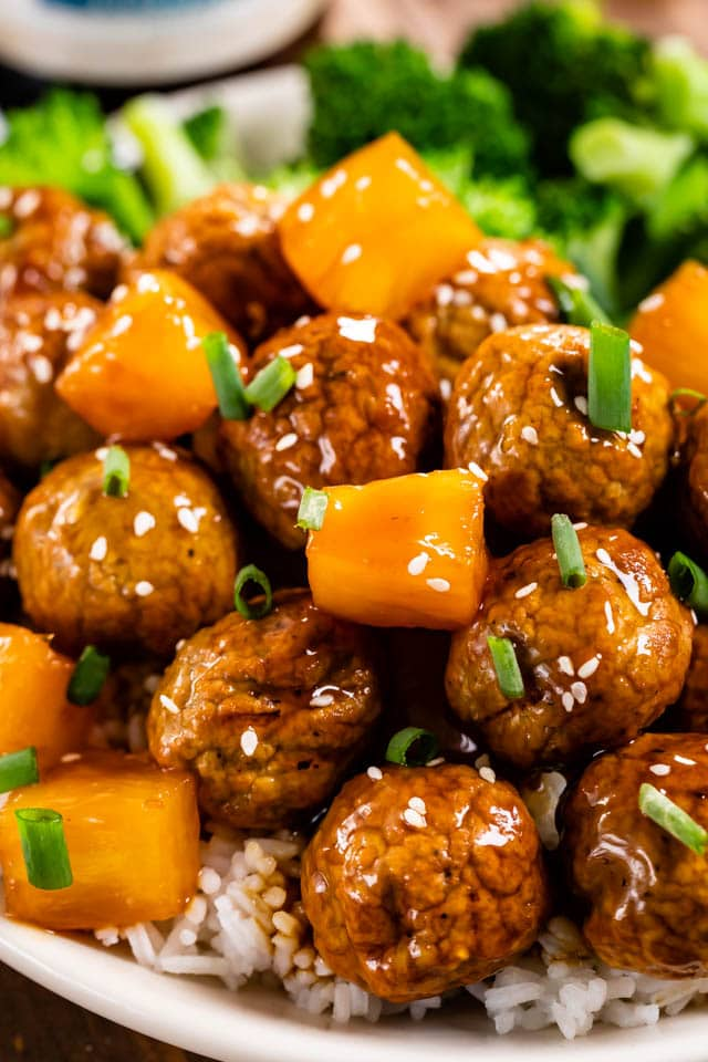 close up of teriyaki meatballs with pineapple on rice