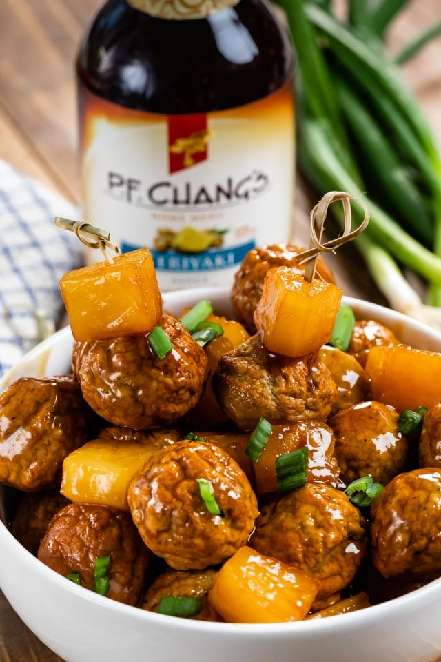 meatballs and pineapple on skewers and in bowl