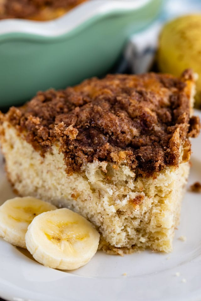 slice of coffee cake with bananas with bite missing