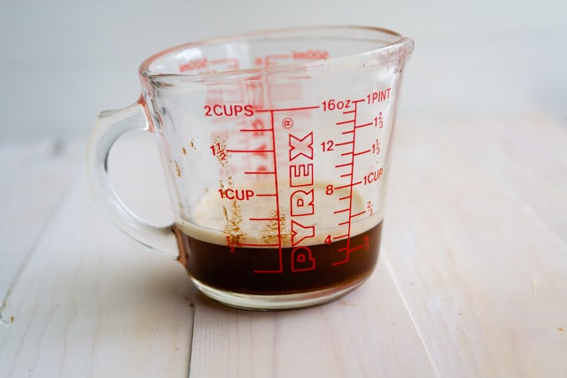 brown butter in measuring cup