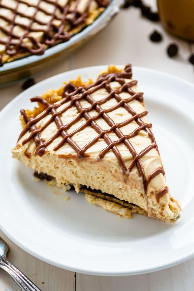 Slice of dulce de leche pie on white plate
