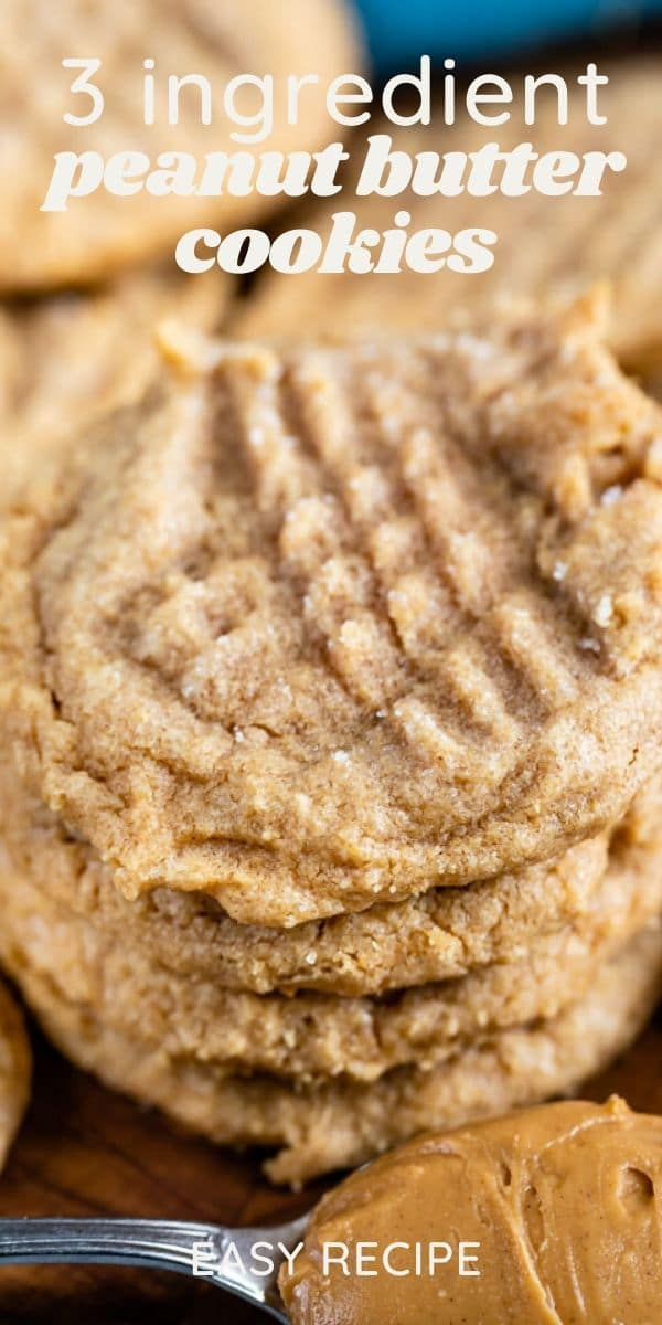 stack of 3 ingredient peanut butter cookies with words on photo