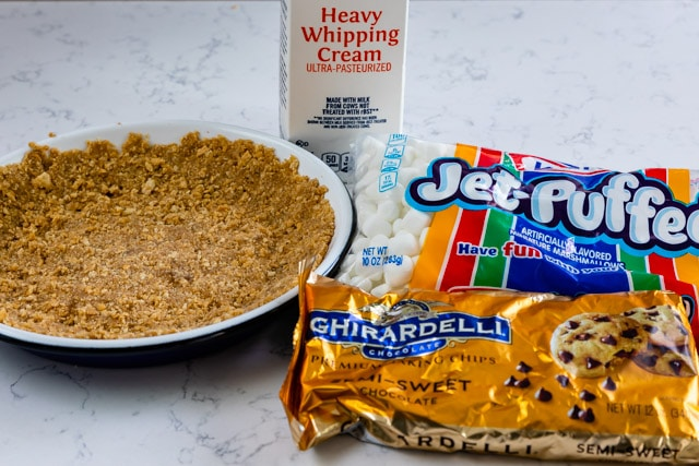 S'mores pie ingredients on a white marble countertop