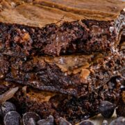 Stack of three brown butter brownies with chocolate chips