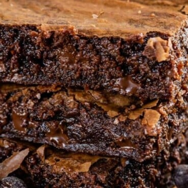 Brown butter brownies stack of three with text on top of photo