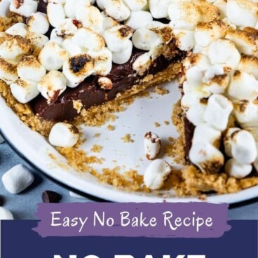 S'mores pie in pie dish with one slice missing and colorblock with recipe title on bottom of image