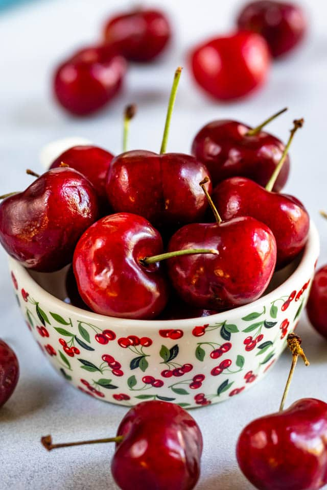 Bowl of cherries in a cherry decorated bowl
