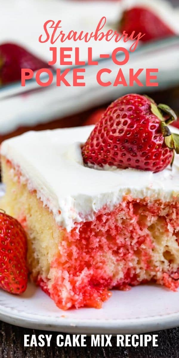 Strawberry jello poke cake on white plate with strawberry on top and one corner missing and recipe title on top of image