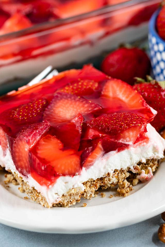 One square of strawberry pretzel salad on a white plate