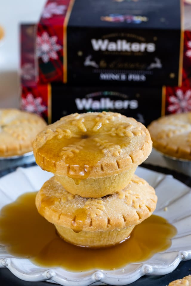 stack of Walkers mince pies with caramel sauce