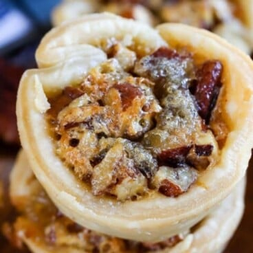 Overhead shot of mini pecan pies with recipe title on top of photo