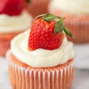Strawberry cheesecake cupcake with white chocolate frosting and strawberry on top