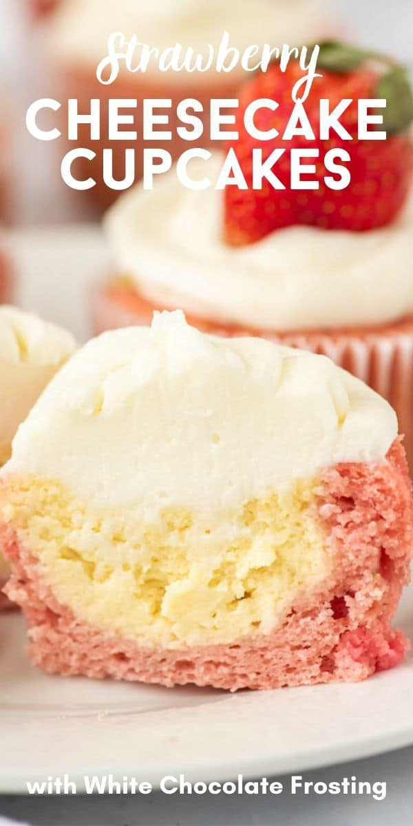 Close up of strawberry cheesecake cupcake cut in half to show filling with recipe title on top