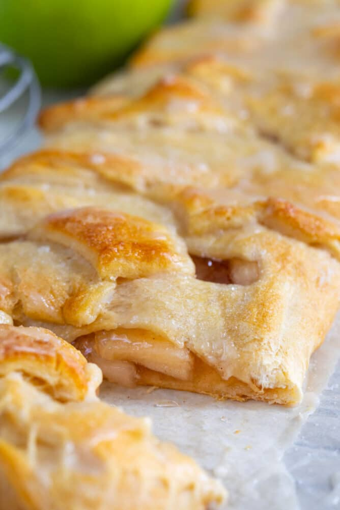 Close up of easy apple strudel braid cut to see middle filling