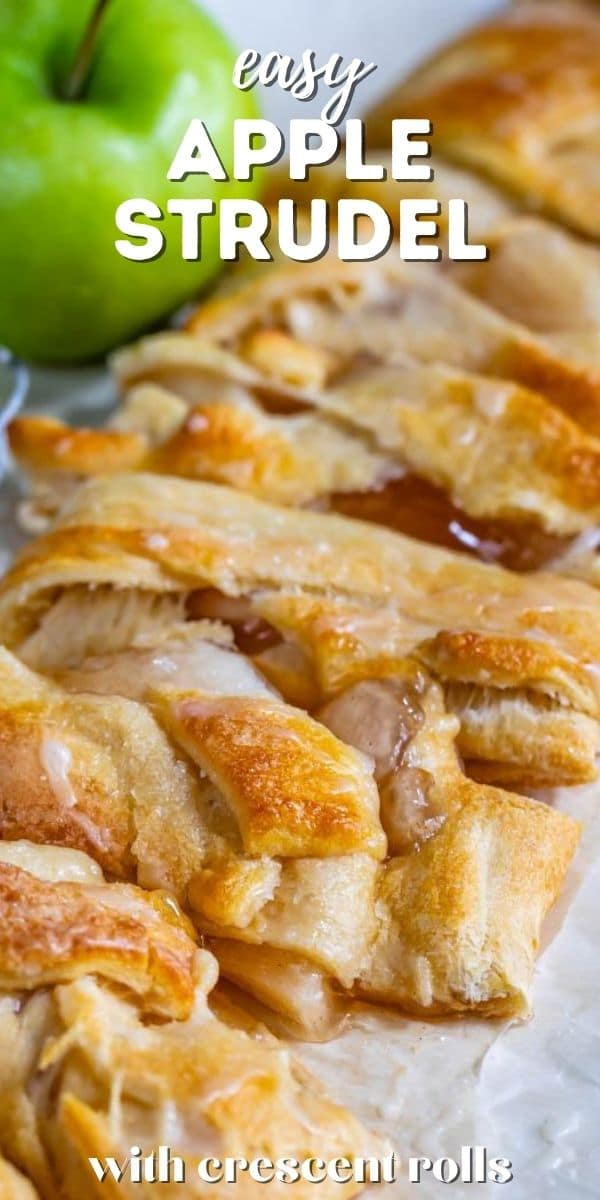 Easy apple strudel cut into pieces on parchment paper with green apple in background and recipe title on top
