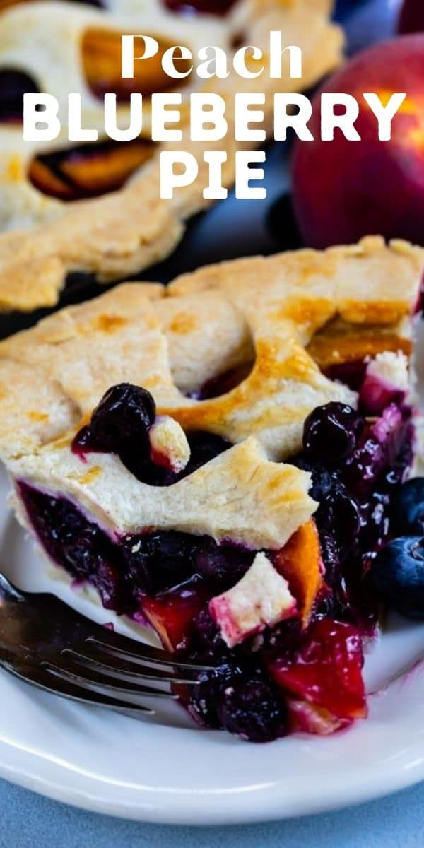 Close up shot of peach blueberry pie slice on a white plate with recipe title on top