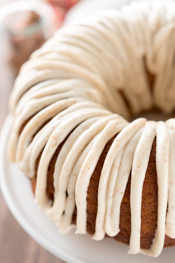 Overhead shot of half of the pumpkin bundt cake with ribbon like frosting