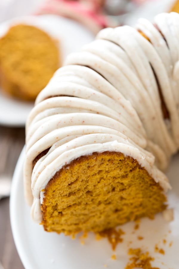 Overhead shot of pumpkin bundt cake with a slice missing to show inside of cake