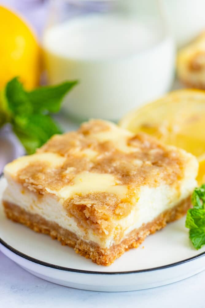 One lemon cheesecake bar on a white plate