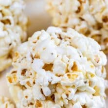 close up of popcorn ball with words on photo