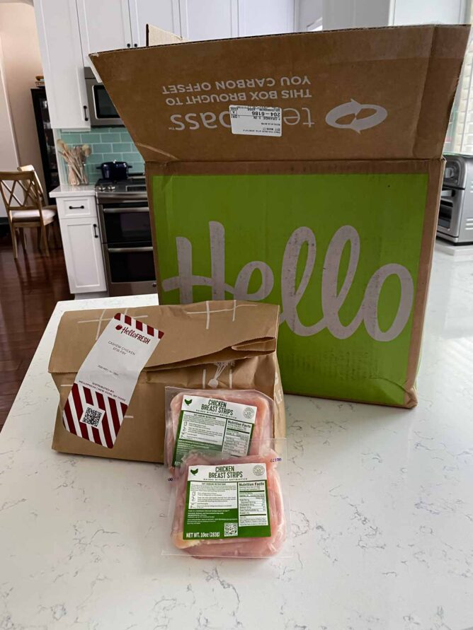 hello fresh box with meal kit on counter and bags of chicken