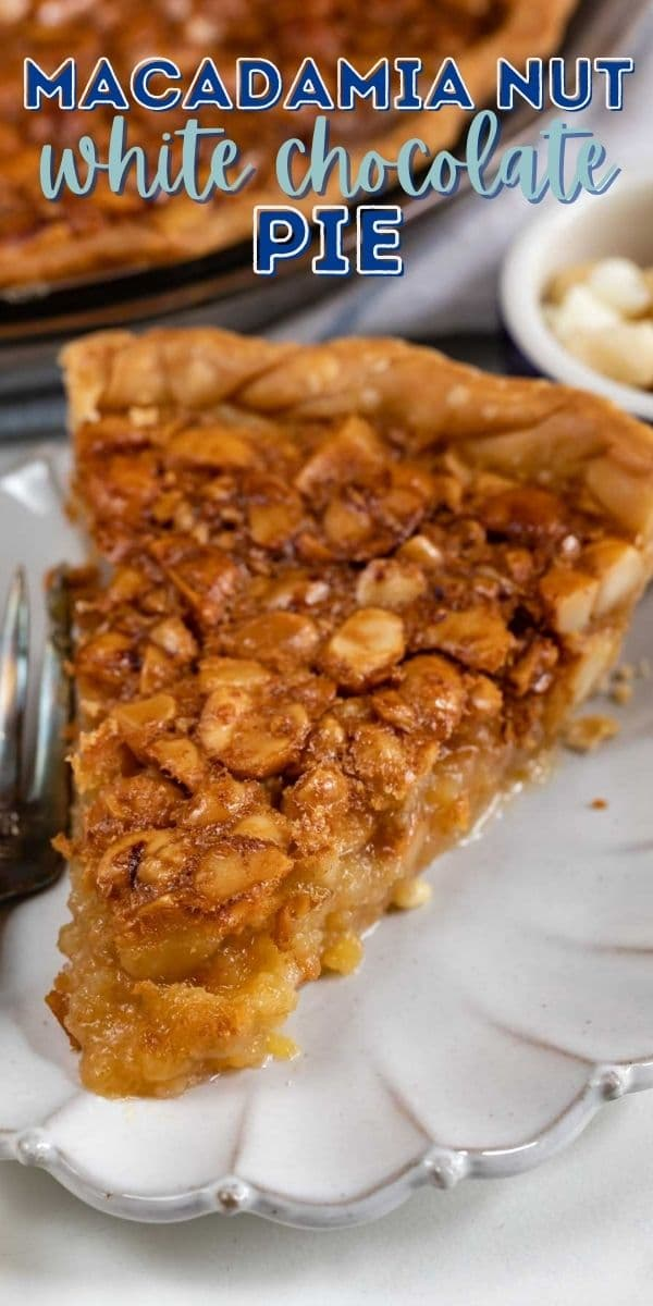 One slice of macadamia nut pie on a white scalloped plate with recipe title on top of image