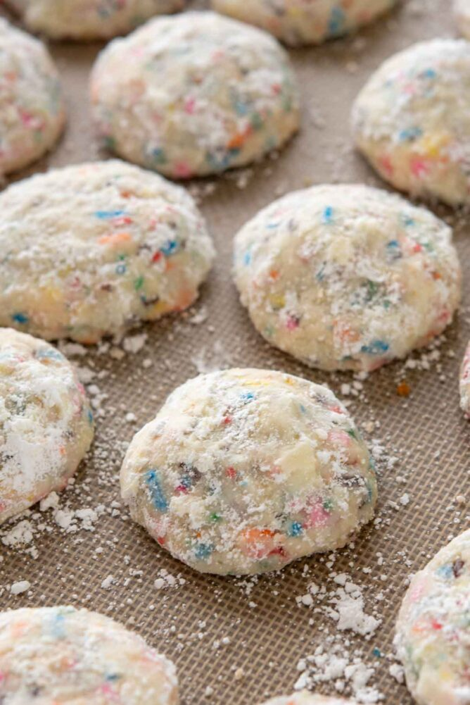 Overhead view of funfetti wedding cookies on a baking mat