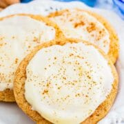 Eggnog snickerdoodles with eggnog frosting on a plate