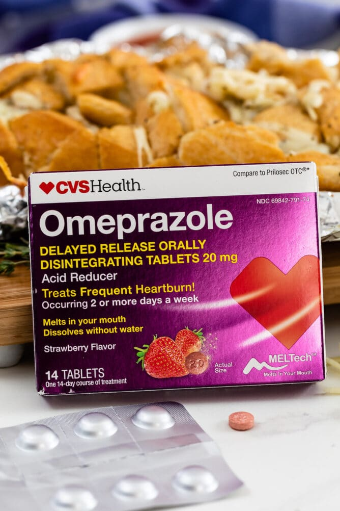 Omeprazole ODT box leaning against bread