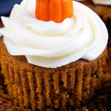 Pumpkin cupcake with a cupcake candy on top and recipe title on bottom of photo