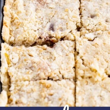 sliced apple slab pie in sheet pan with spatula and words on photo