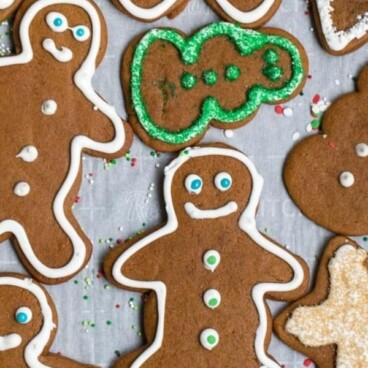 overhead shot of gingerbread men on parchment with words on photo