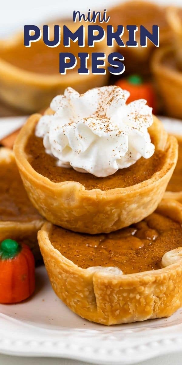 Close up photo of mini pumpkin pies stacked on top of eachother and the top one has whipped cream and recipe title on top of photo